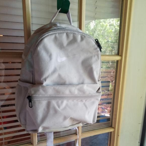 Light Pink Nike mini backpack.